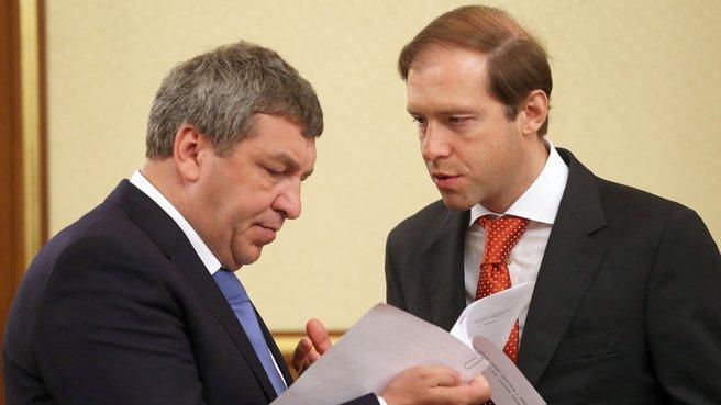 Глава Минрегиона Игорь Слюняев и глава Минпромторга Денис Мантуров