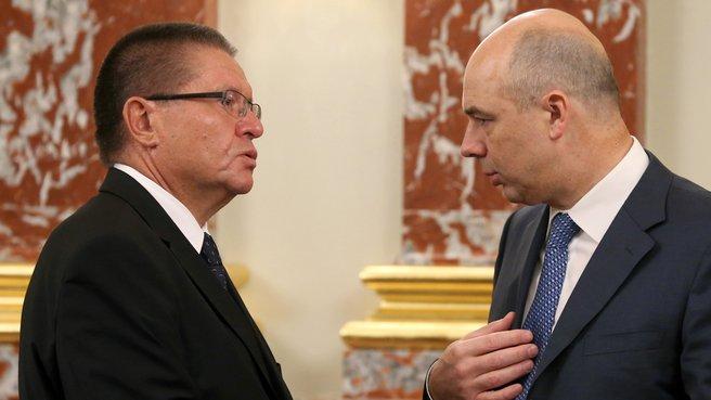 Глава Минэкономразвития Алексей Улюкаев и глава Минфина Антон Силуанов